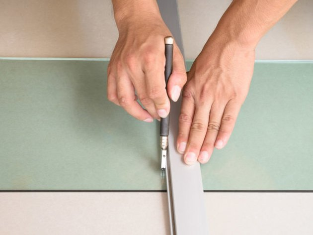 hands scoring glass