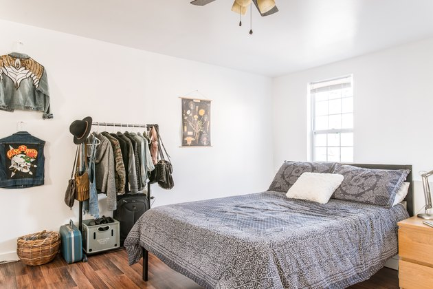 bedroom idea with wardrobe rack and jackets hung on wall