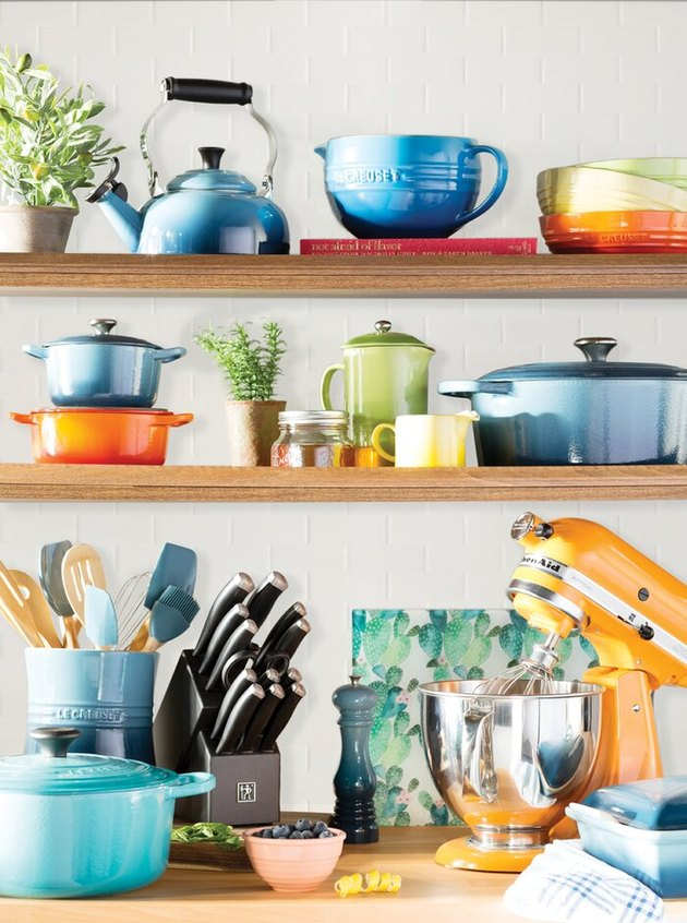 colorful kitchenware on shelves and counter