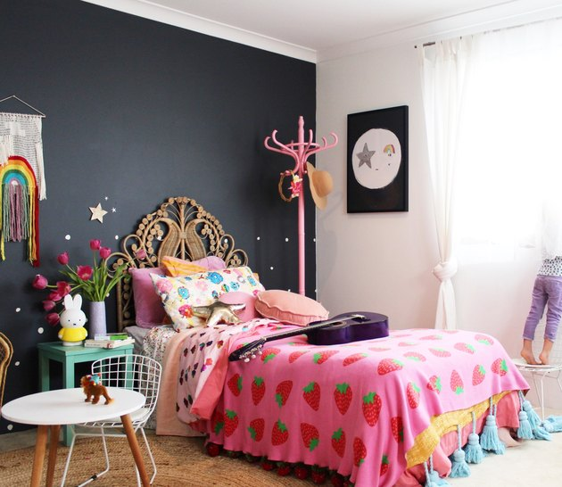 bohemian kids bedroom idea with tasseled blanket and woven headboard
