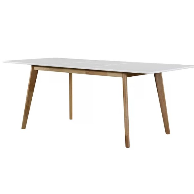 Minimal rectangular dining table with wooden legs and white top