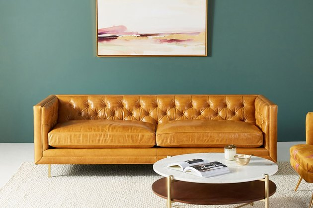 leather couch in living room space with marble coffee table