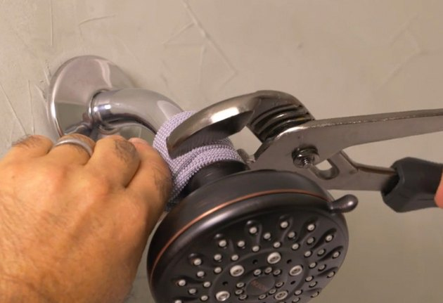 Pliers removing shower head