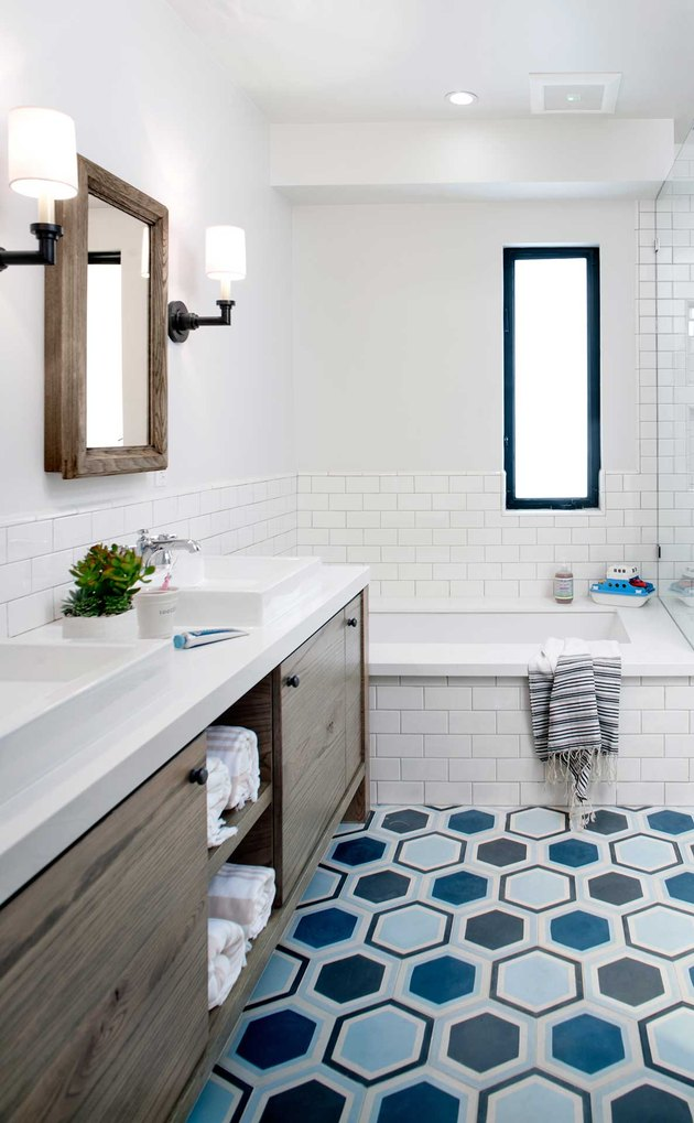 kids bathroom idea with colorful hex tiles, white subway, walnut vanity