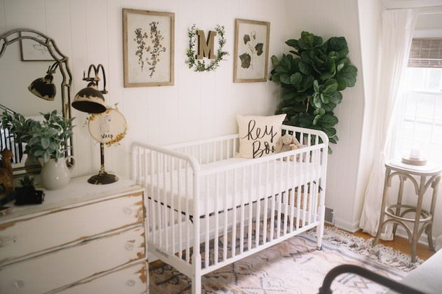 nursery idea with flea market decor and fiddle leaf fig tree near crib