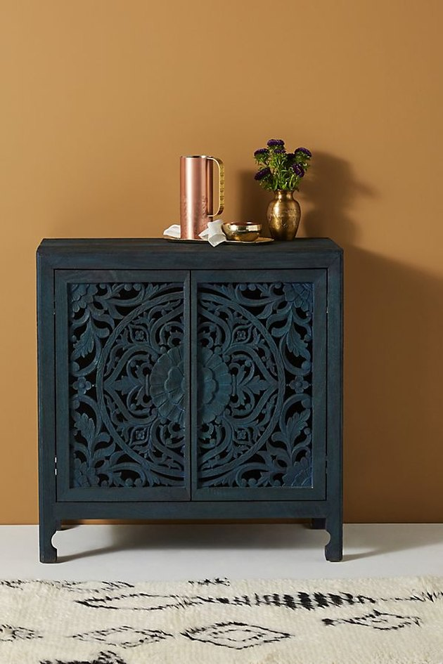 entryway cabinet with plant and decor