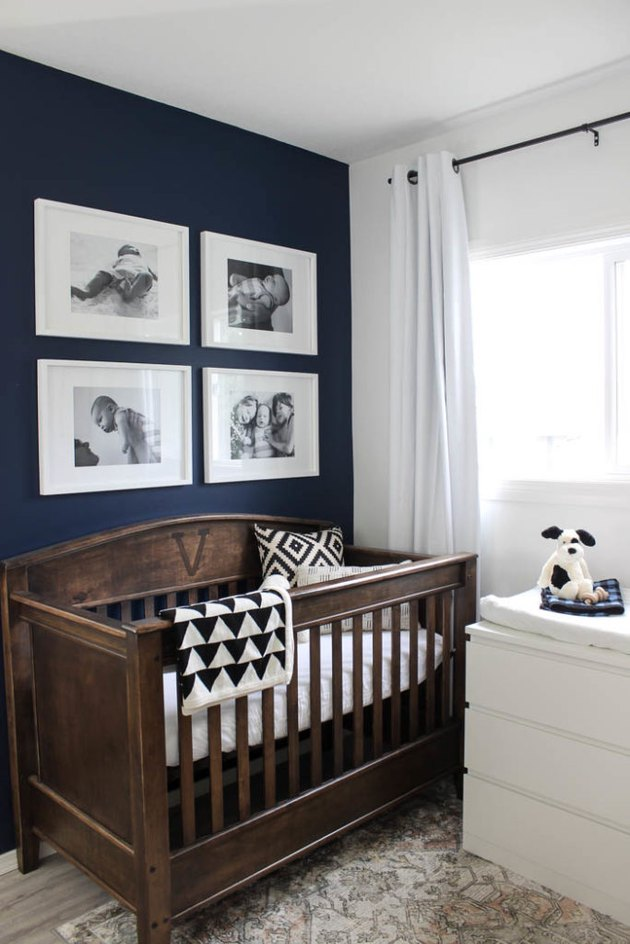 blue nursery idea with framed photos hanging above wooden crib