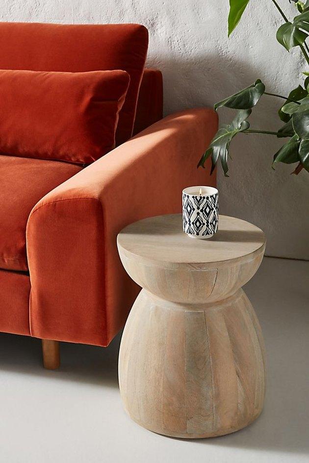 side table near velvet sofa