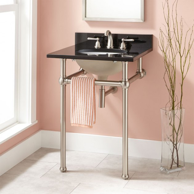 pink bathroom with single console bathroom sink
