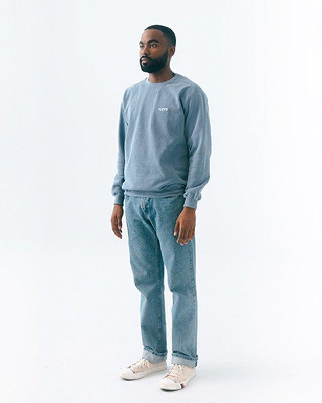 model wearing crewneck sweatshirt