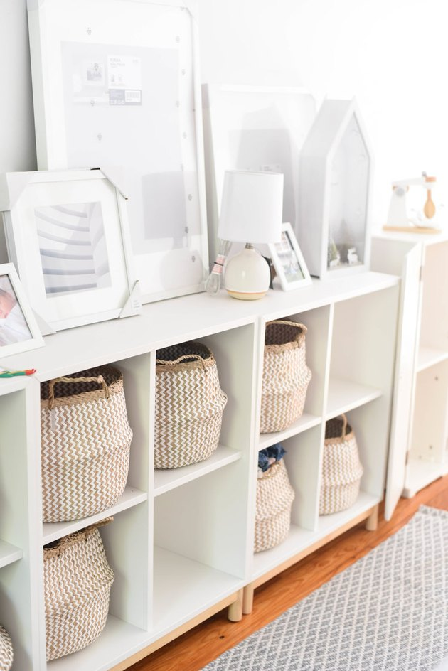 Baskets in cubbies playroom storage idea with white furniture and decor