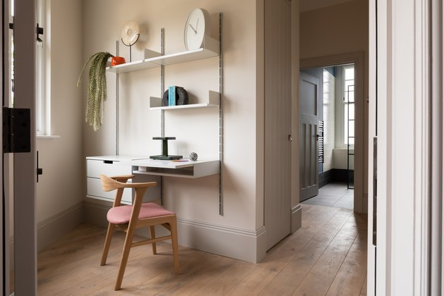 blush modern home office installed in a corner with wall unit that includes desk and chair