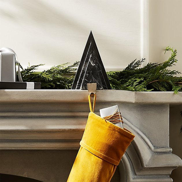 black marble stocking holder with mustard colored stocking