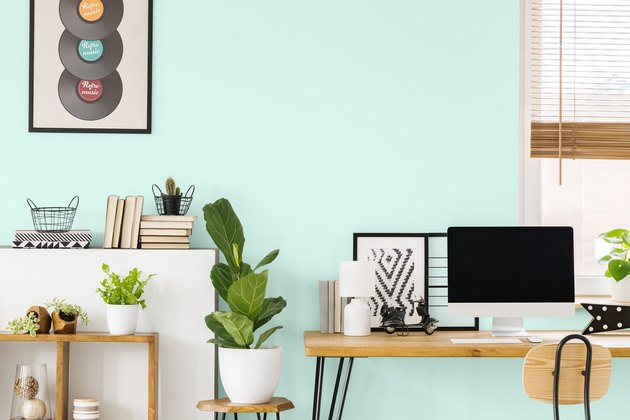 desk and office space with mint wall