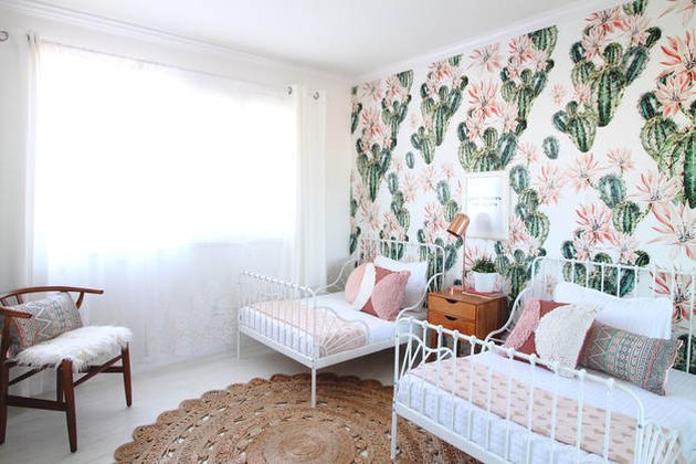 green kids bedroom idea with cactus wallpaper, white iron beds