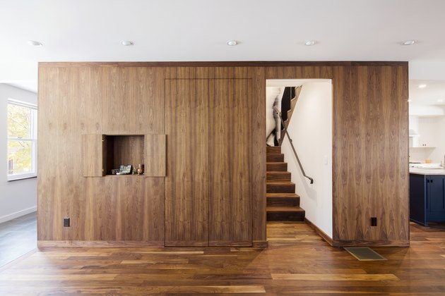 entryway with walnut built ins