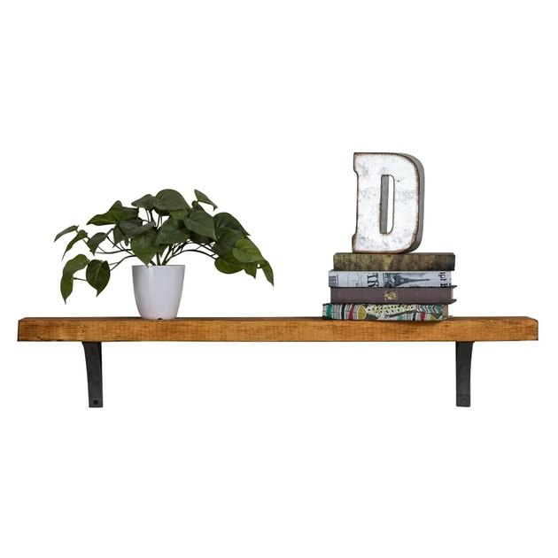 Wooden shelf in medium finish with black brackets