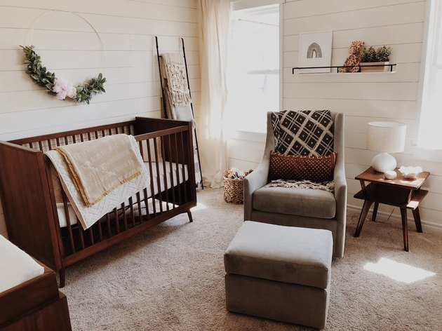 farmhouse nursery idea with floral wreath on shiplap walls