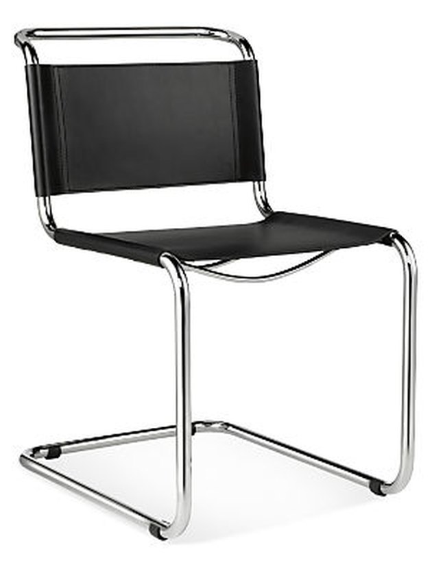 Chrome armless mid-century-inspired dining chair with black leather seat and back