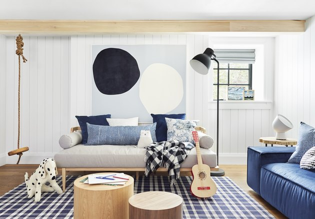 Cali-cool kids playroom idea with exposed wood beams at ceiling and hanging swing