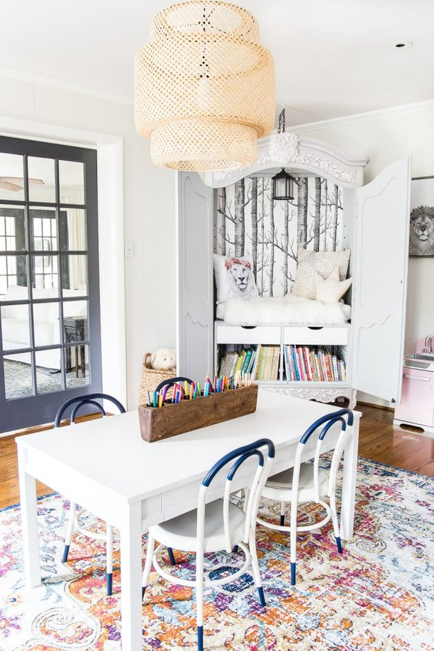kids playroom idea with reading nook inside cabinet with table and chairs for arts and crafts