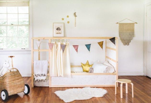 Add wallpaper to the IKEA Kura bed panels.