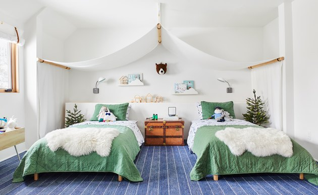 green kids bedroom idea with bed canopy over two twin beds with green bedding