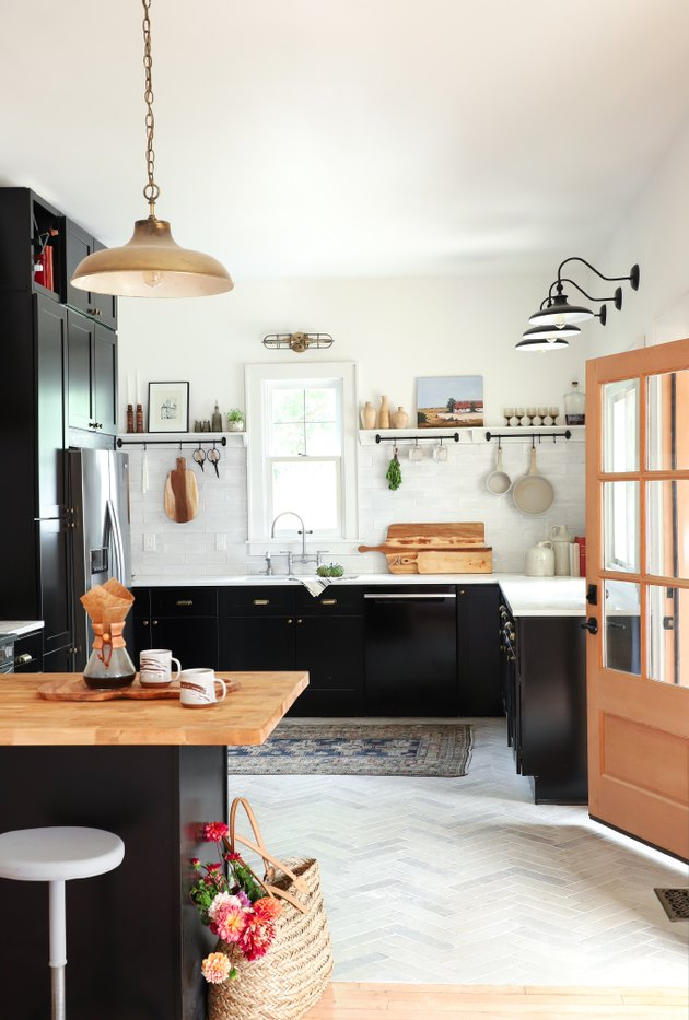modern kitchen with black wood cabinets