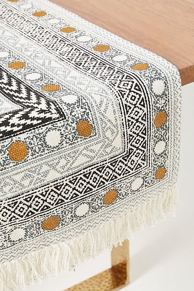 gold, black, and white holiday table runner