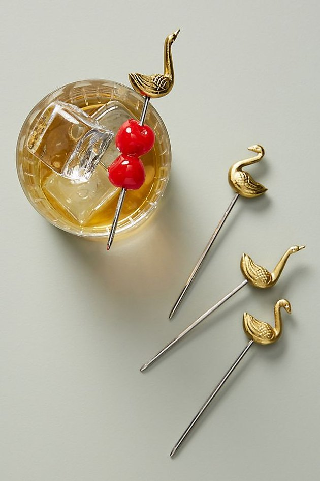 gold and silver swan cocktail picks