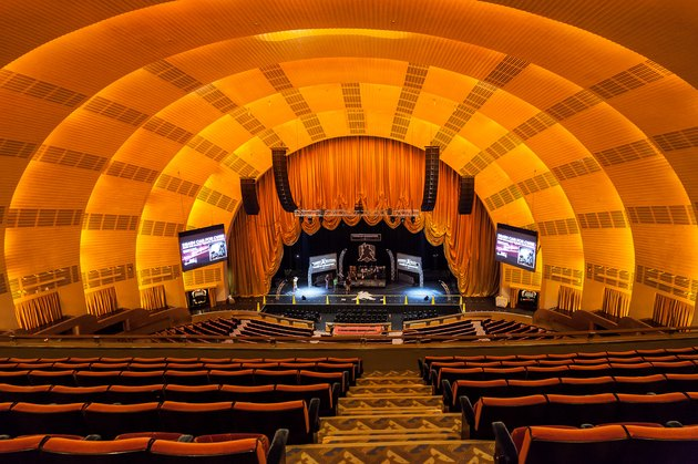 interior of Radio City Music Hall with seats and stage