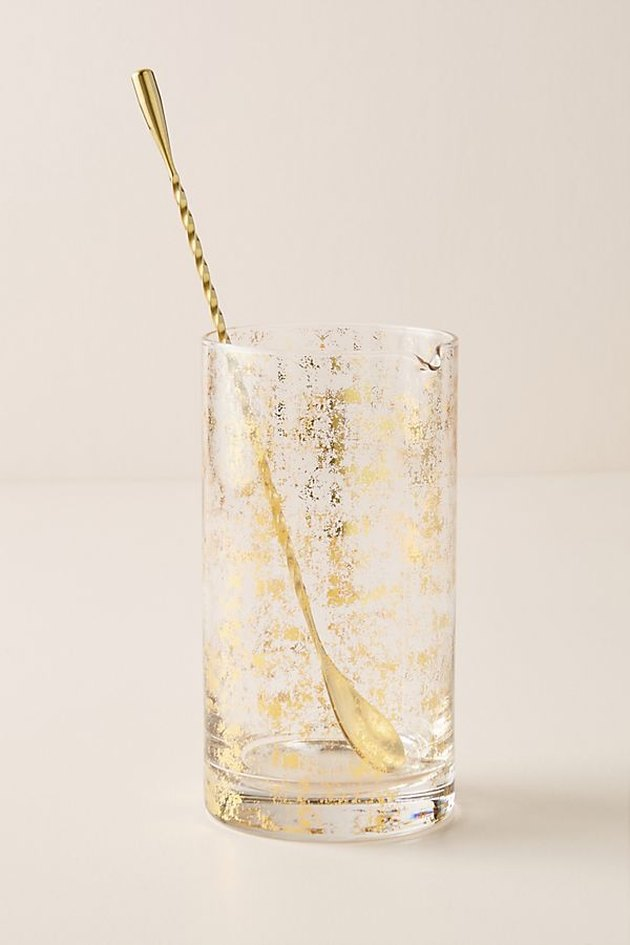 gold glass pitcher with spoon