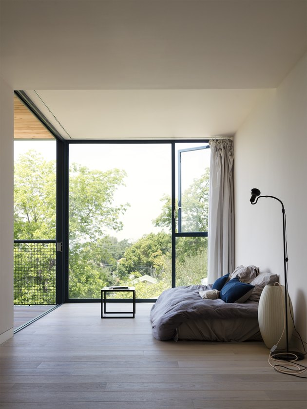 minimalist bedroom with large windows