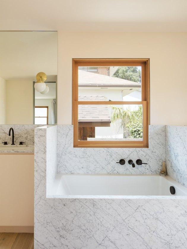 bathroom with marble bathtub