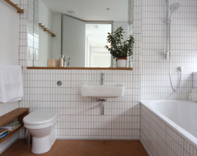 minimalist white bathroom with cork flooring