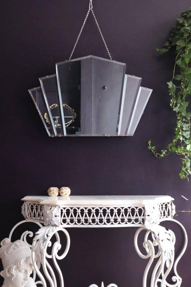 art deco mirror near white table