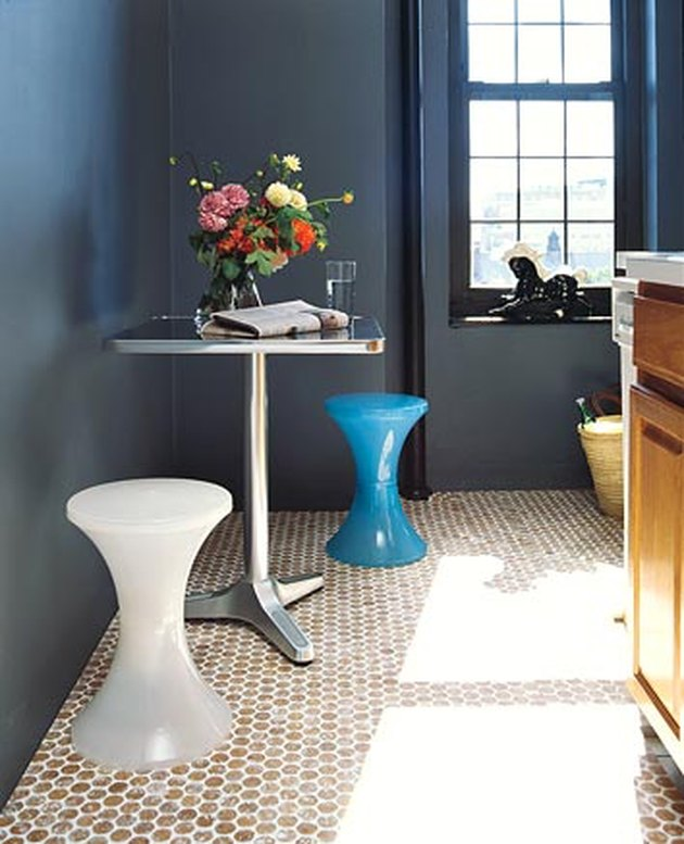 blue bathroom with round cork penny tile flooring