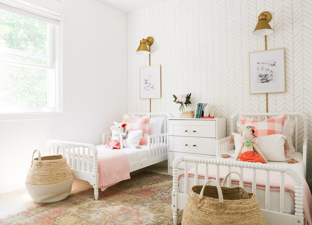 kids' bedroom idea with white furniture and brass sconces
