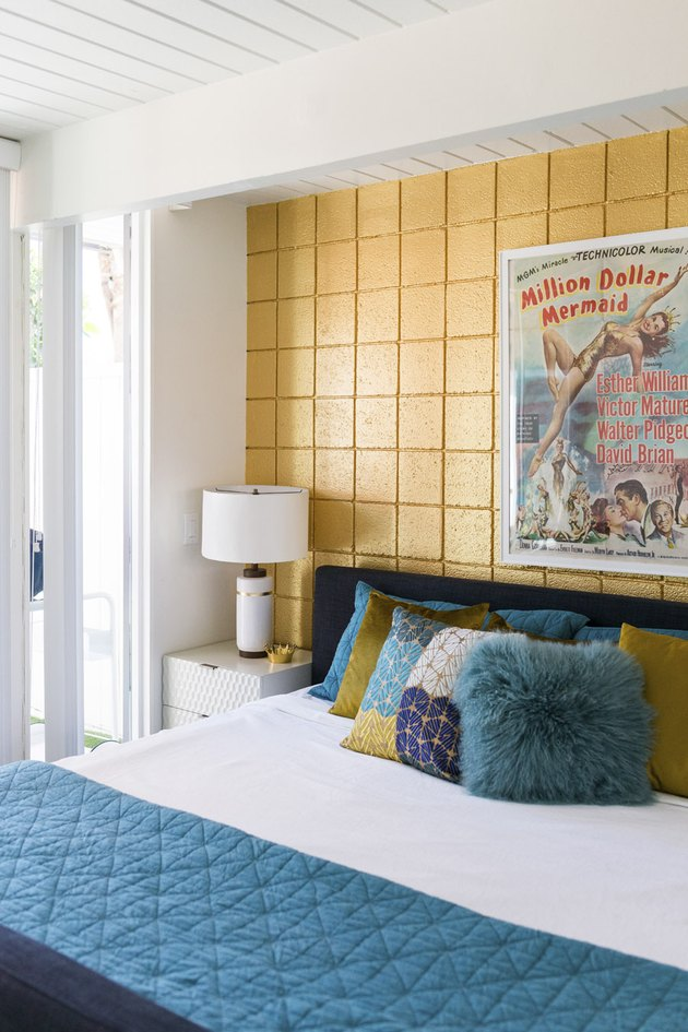 bedroom with yellow brick wall