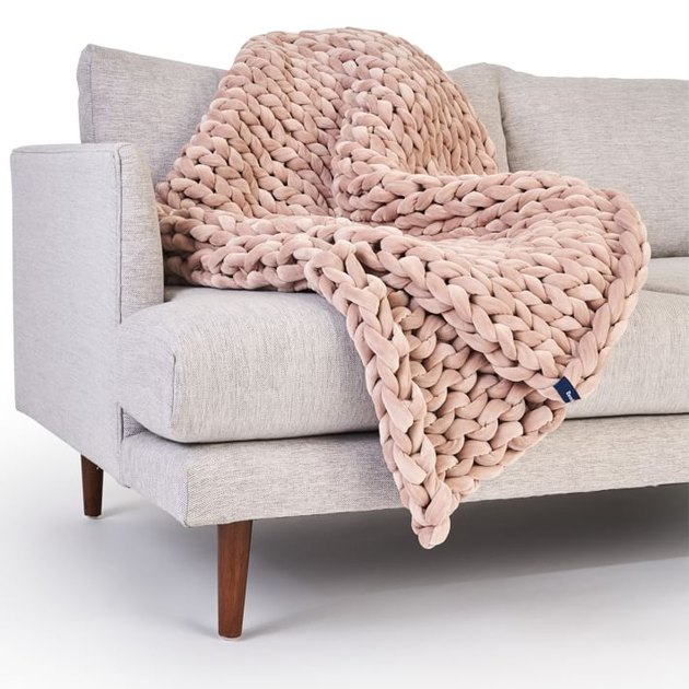 blush blanket on couch