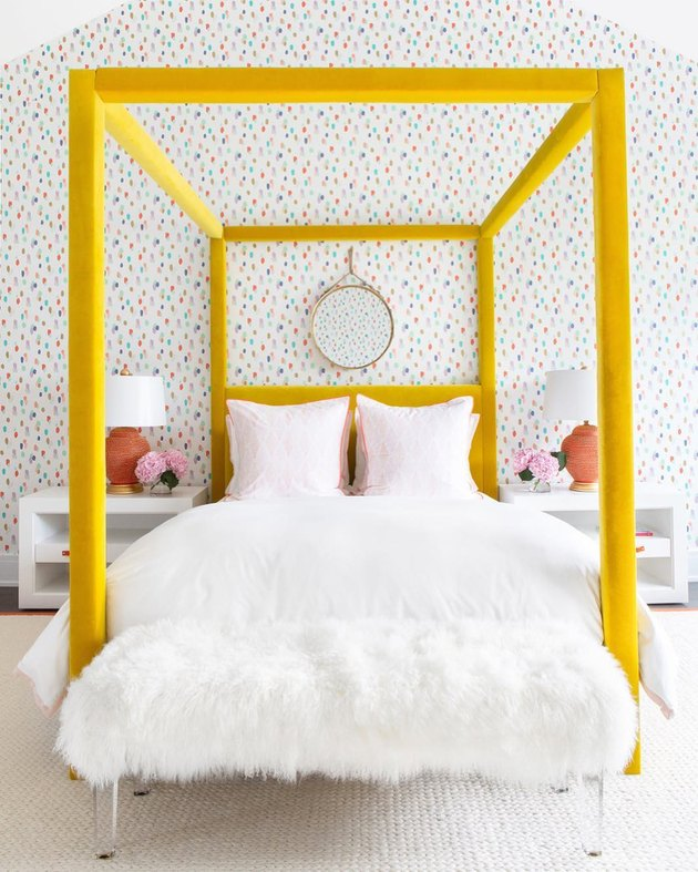 yellow four poster bed