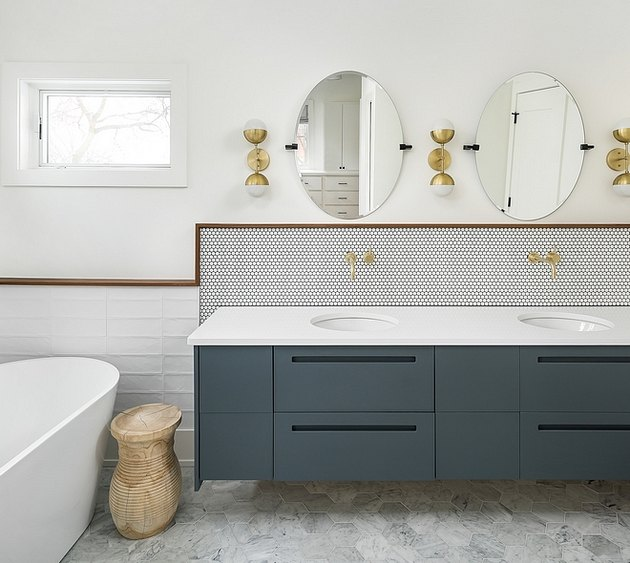 framed mosaic tile bathroom backsplash idea in modern space with midcentury lighting