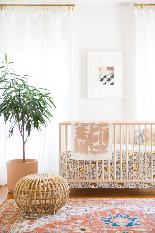 modern nursery idea with rattan decor and patterned rug