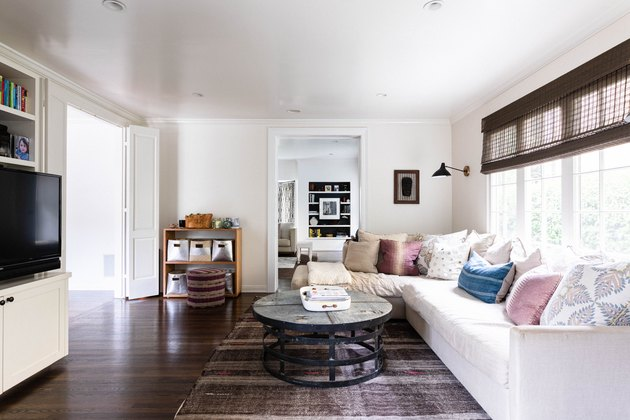 neutral-color living room with hardwood flooring