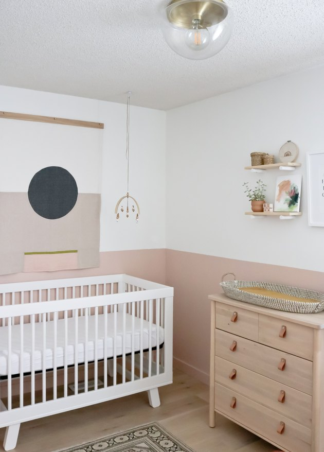 white and pink modern nursery idea with modern boho decor
