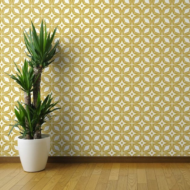 Yellow and white midcentury modern wallpaper with star shapes