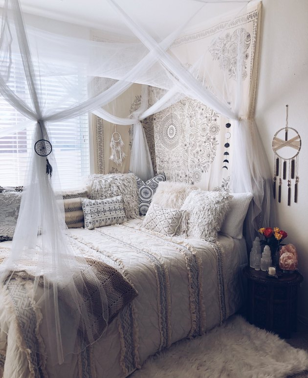 bohemian bedroom idea with layered textiles and bohemian decor in bedroom