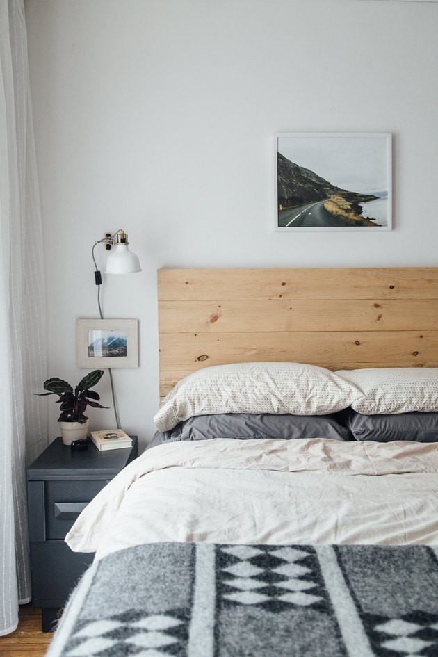 bohemian bedroom idea with DIY headboard, industrial accents, and wall sconces