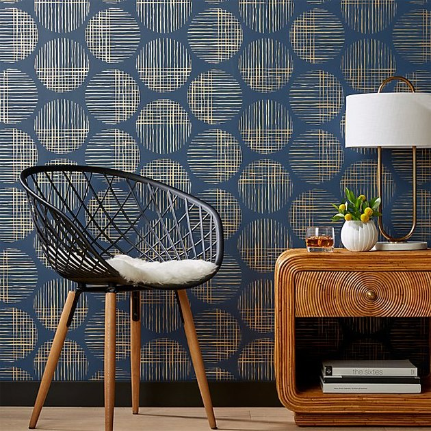 Midcentury modern wallpaper with cross hatch circles in blue and gold
