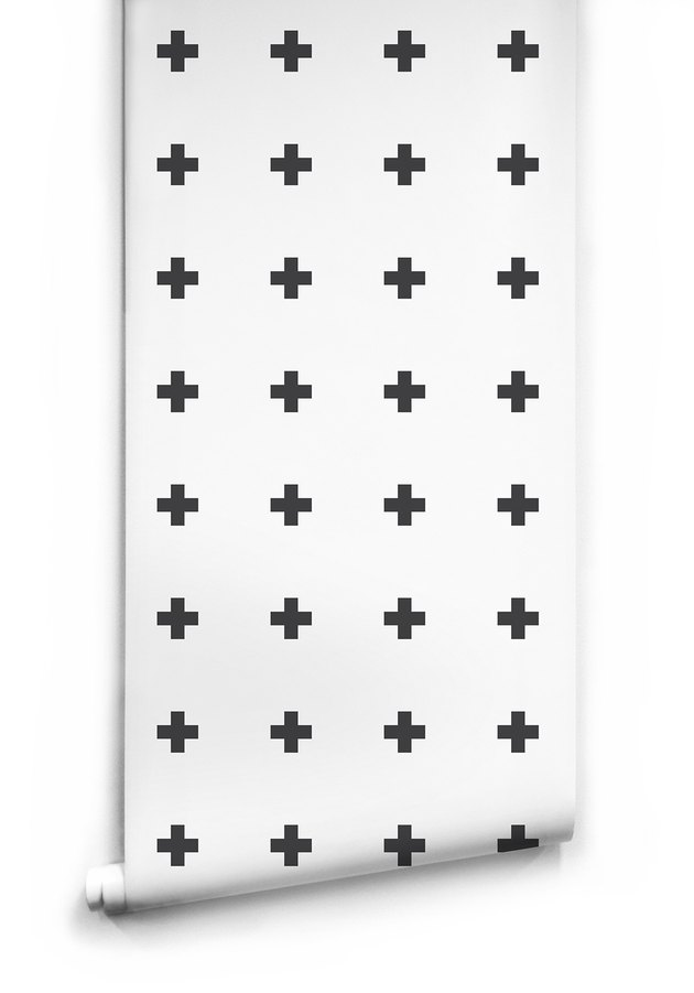 White wallpaper with bold black plus sign pattern